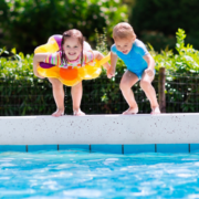 Two Children Diving into A Pool